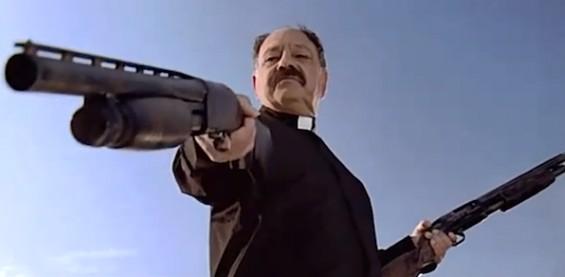priest with gun